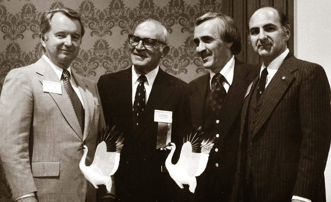 "Clark Akers, Dr. Greer Ricketson, Tony Campbell and Dr. Edward Thackston pose for pictures during the National Wildlife Federation's 1980 annual convention in Miami. Akers received one of the whooping crane statuettes for his success in stopping the West Tennessee Tributaries Project. Thackston accepted the other ""Connie"" for the Tennessee Conservation League as outstanding NWF affiliate for 1979."